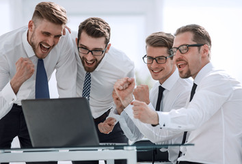 happy business team looking at the laptop screen