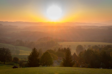 Nice sunset on hills with meadow and trees, Czech landscape