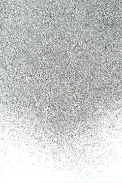 Background of the silver sparkles on white.