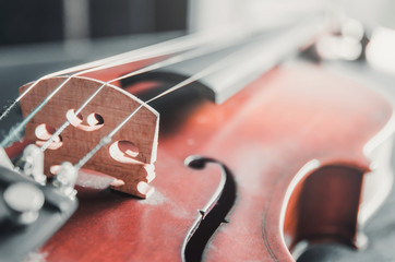 The violin on the dark table, Classic musical instrument used in the orchestra.