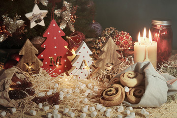 Four decorative wooden Christmas trees with carved letters xmas and christmas sweets. Christmas family traditions.