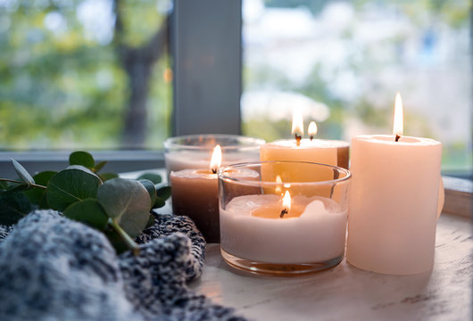 Beautiful burning candles on wooden table