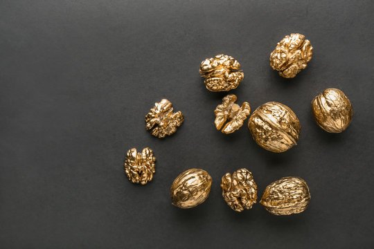 Golden walnuts on black background