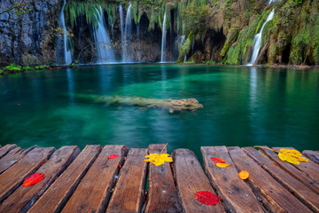 Plitvice Lakes. Image of waterfall located in Plitvice National Park, Croatia during autumn day.