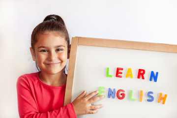 Language education concept. Learn English. Do you speak English. Cute little child girl with...