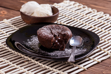 Mouth watering delicious chocolate fondant cake, restaurant serving.