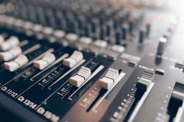 Audio equalizer close up. Studio audio volume mixer. Professional audio equipment.