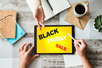Black friday sale. E-commerce and online shopping concept on tablet screen.