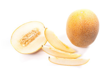 Whole, half and sliced honeydew melon tropical fruit isolated on a white background.