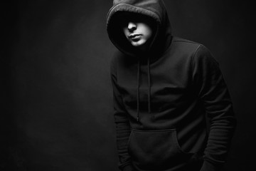 Man in Hood. Boy in a hooded sweatshirt