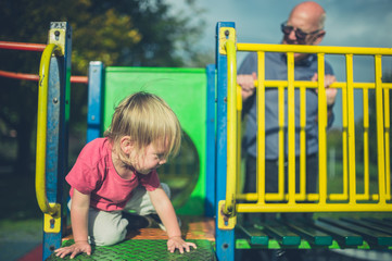 Toddler and grandfather at the playground