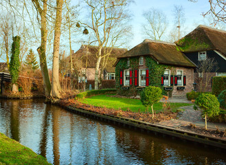 Canal in Giethoorn at sunny  winter morning, Netherlands. Giethoorn is a village in the Dutch province of Overijssel.