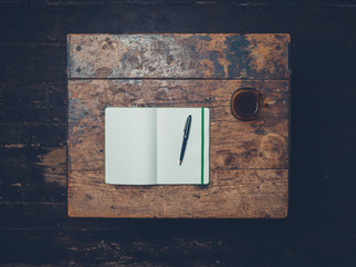 Overhead shot of pen and notebook