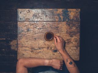 Overhead shot of man drinking coffee