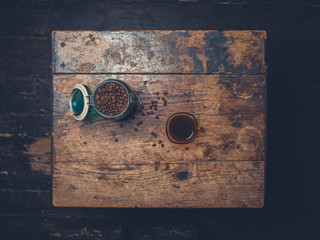 Coffee beans and cup on table
