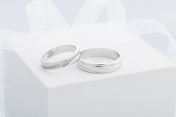 Pair of white gold wedding rings with diamonds in womens ring