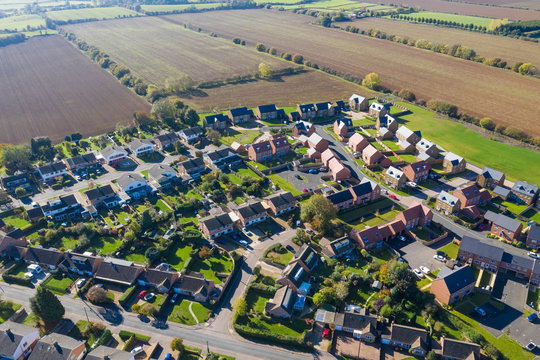 Aerial view of homes in a rural village setting in England