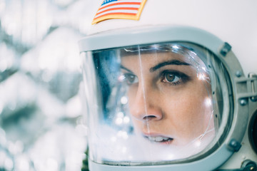 Beautiful woman poses dressed as an astronaut.