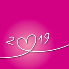 Carte de vœux 2019 avec un cœur sur fond rose pour symboliser l'amour