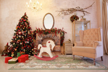 Christmas tree is dressed up in a room.