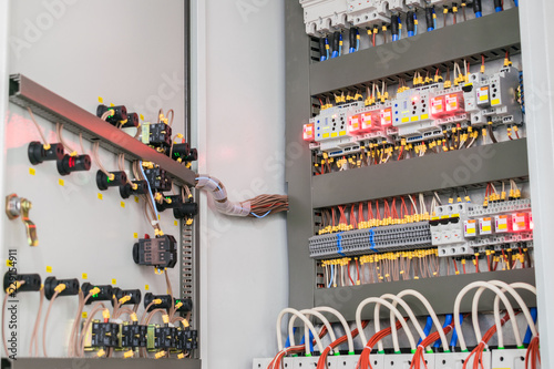 An open fuse box is on the wall in the basement  High