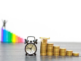 coins stack and clock and aircraft on wooden table, finance and investment concept ,growing money ,