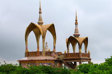 Long shot of two arched domes and a sitting Buddha, at Pha Sorn Kaew, in Khao Kor, Phetchabun, Thailand.