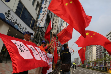Pro-China supporters wave Chinese flag before the opening of Summer Universiade, in Taipei