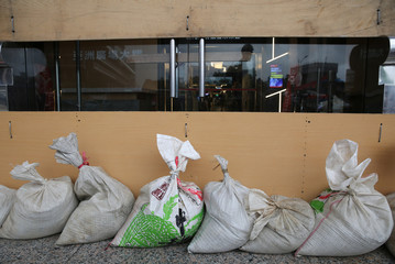 Sand bags to prevent flooding are placed at the entrance of a building iin Taipei