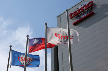 Flags of Taiwan and Taiwan Semiconductor Manufacturing Co (TSMC) are displayed next to its headquarters in Hsinchu