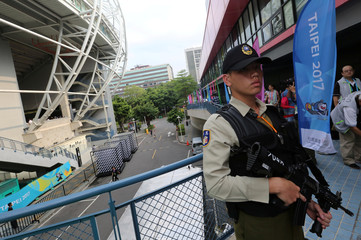 MP stands guard before opening of 29th Summer Universiade, in Taipei