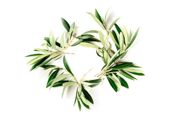 An overhead photo of a wreath made up of olive tree branches, a circular frame with copy space, shot from above on a white background