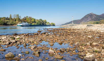 Vessel on river Rhine with low water level by Bad Honnef and Drachenfels, Germany
