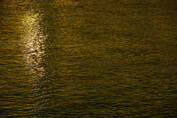 Ripples on the water in the yellow light
