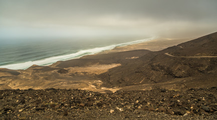 Dirt road along ridge of hills along coast of Cofete, Fuerteventura, Spain.