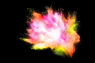 Colorful powder explosion on black background. Colored cloud.