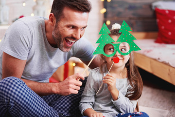 Father and daughter having fun at christmas time