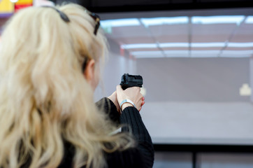 Woman shooting in virtual shooting gallery