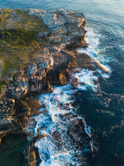 Aerial view of rock cliff along Maroubra coastline. Sydney, Australia.