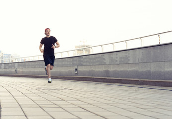 Fit athlete running outdoors to stay healthy