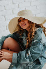 Charming and sweet girl. In Hat