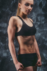 Muscular female on gray background
