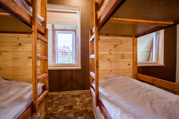 Bunk wooden beds in the comfortable hostel