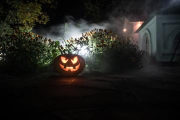 Halloween pumpkin. Carved Halloween pumpkin glowing in the dark.