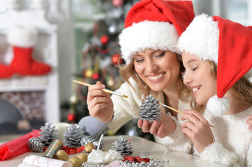 Portrait of girl with mother preparing to Christmas