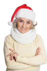 Portrait of senior woman in Santa hat isolated