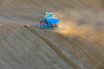 Autocollant pour porte Culture autumnal sowing in the field with modern mechanisms