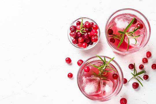 Cocktail with cranberry, vodka, rosemary and ice.