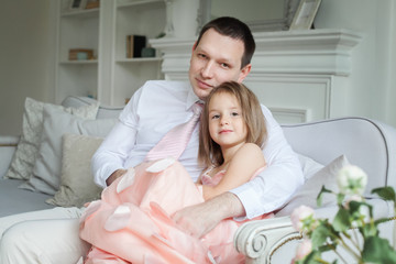 Father and daughter together at home, portrait