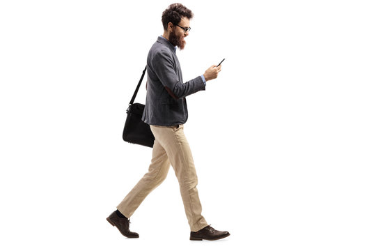 Man walking and looking into a mobile phone